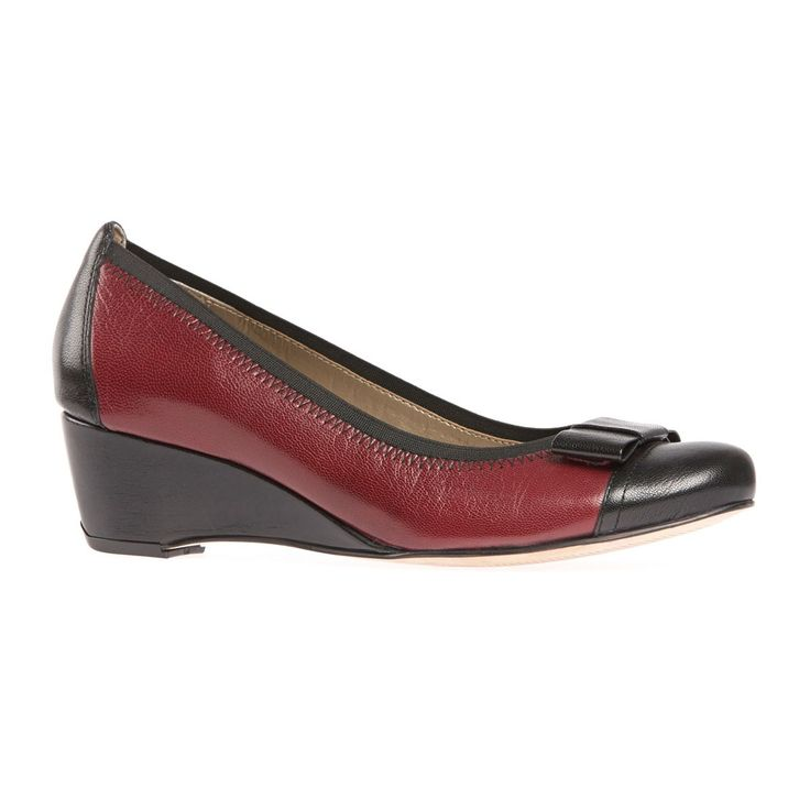 A true day wedge, Mayfield is a great multi-purpose wardrobe option. Crafted from soft black and bordeaux red leathers, Mayfield sits on a 45mm heel and sports a neat rectangular leather bow, feature stitching and toe cap detail. A generous D width fitting ensures comfort is guaranteed.  Available in two other perfect autumn friendly colours.