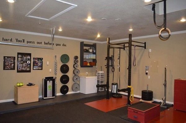 Garage gym ideas don't get any better than this quote inspired brown theme garage gym with weights on walls and a power rack