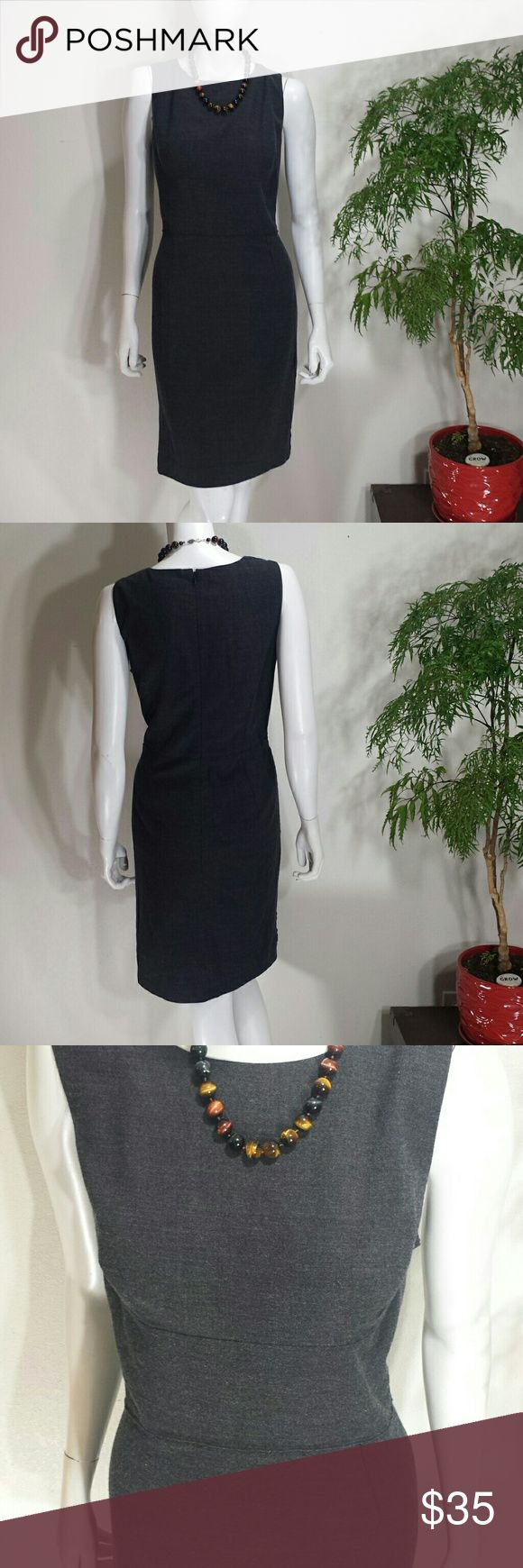 """Ann Taylor sz 12 Grey Wool Dress Size 12 Ann Taylor Dress Grey in color with revealed seams  Shell 71% wool  26% nylon 3% spandex   Lining 94% polyester 6% spandex  Approximate measurements when flat 18.5"""" armpit to armpit 39"""" shoulder to hem 17.5"""" waist  8"""" armpit to waist  22"""" waist to hem Ann Taylor Dresses Midi"""
