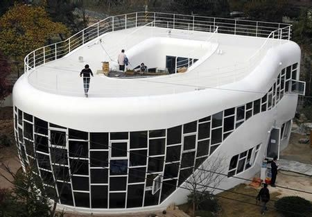 The Toilet-shaped house, in Suwon (South Korea). South Korean sanitation activists marked the start of a global toilet association right here on November 21, 2007, by lifting the lid on the world's first lavatory-shaped home that offers plenty of water closet space.