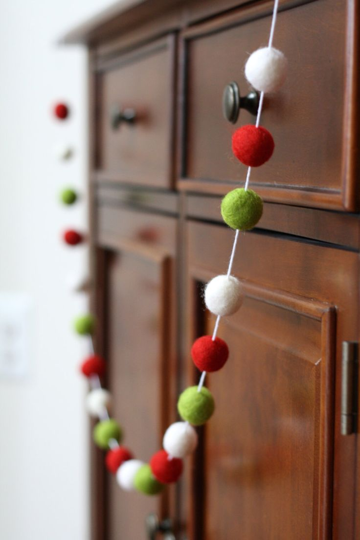 Modern Christmas Felt Ball Garland, Holiday Pom Pom Garland, Banner, Party Decor by GracieAndMarie on Etsy https://www.etsy.com/listing/214126577/modern-christmas-felt-ball-garland