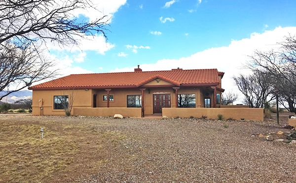 2/27/17. 4BR/2BA, 2.5 car garage custom on 9.12 fenced acres. Stained wood floors & woodwork, Travertine tile, gourmet kitchen, upstairs observatory w/great mtn views. Detached 7 car garage w/bar area, 4 stall horse barn (or RV). $449,000. Call Kelly Blue, 520-678-3502, or email kelly.blue09@gmail.com. ERA Four Feathers Realty LC. Direct MLS link at www.AZrealestatepress.com. Get more info on page 35 of the current REP.