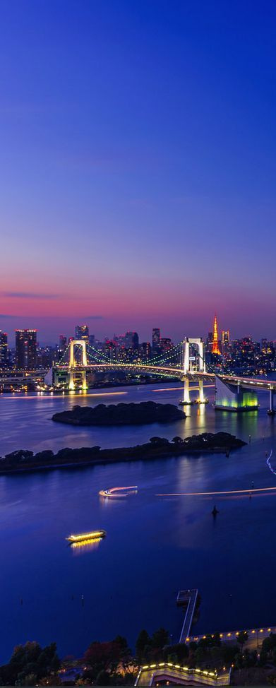 Sunset in Tokyo Bay featuring the Rainbow Bridge; view from Odaiba