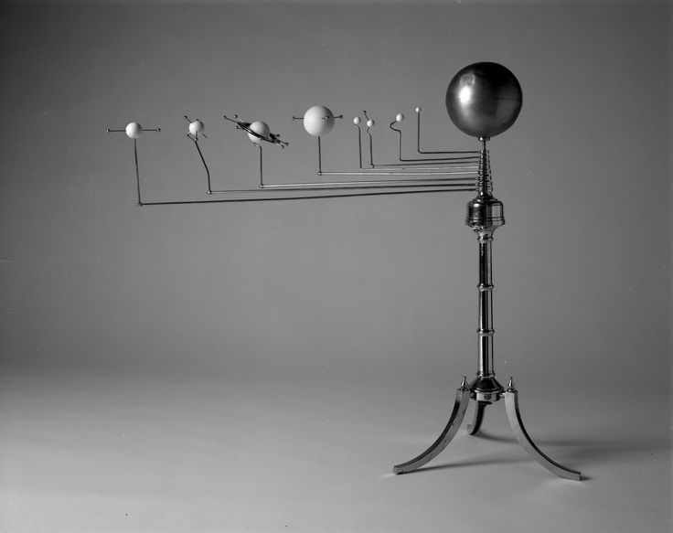 "10 years ago today, August 24: The International Astronomical Union declares Pluto no longer a planet, changing its status to ""dwarf planet."" Pluto was discovered in 1930. This orrery was made before that discovery but after the discovery of Neptune in 1846.  An orrery is a mechanical model of the solar system."