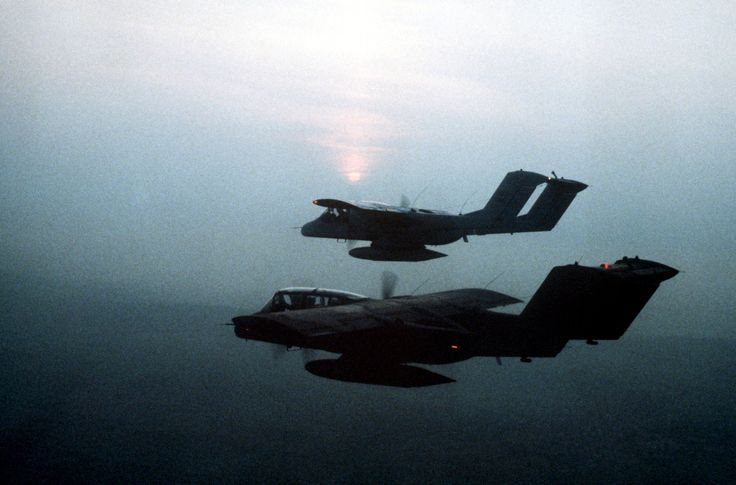 """uss-edsall: """"A view of two OV-10 Bronco aircraft, silhouetted against the sunset, in flight. The aircraft are assigned to the 4th Tactical Air Support Squadron, 601st Tactical Control Wing, involved..."""