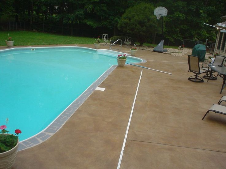 Stained Concrete ideas for our pool. I like the stone around the edge of the pool then the stained concrete around.