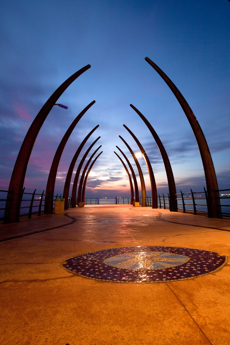 Umhlanga Pier, looks like a whale carcass. BelAfrique - your personal travel planner - www.BelAfrique.com