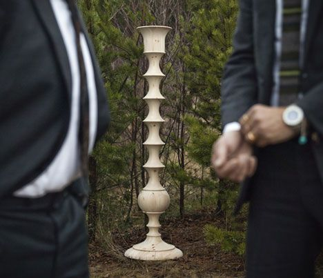 Stockholm designer Anki Gneib challenged artistic collective SX70 Europe to transport her enormous carved candlesticks from their place of manufacture in the woods of Sorvi-Pojat in Finland to her studio in Stockholm. They decided to wear suits for the occasion and photograph the journey.