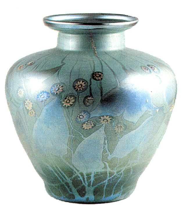 Milifori vase from the large Collection of Tiffany donated by Joseph Briggs to the Haworth museum in Actrington Lancs were Briggs was born When art nouveau & Tiffany passed into the dark years of obscurity in the 1930s Joseph had the unenviable task of closing down a company that was a shadow of its former self literally throwing away large stocks of unsold items. At the same time he also sent more than 130 of the finest Tiffany pieces back to his home town.