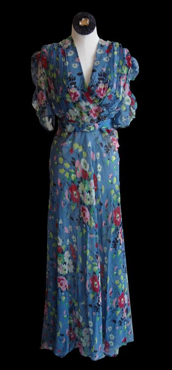 ~1930s Blue Floral Gown: vibrant floral chiffon w/matching belt~    Via Silver Moon Vintage.