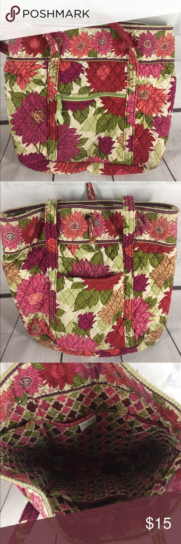 Vera Bradley tote bag Great condition but the top of the straps are frayed a bit and the pic shows it. The strap measures 12 inches, the width of bag is 17 inches and the height is 15 inches. There is a front pocket on both sides and 6 pockets inside. Vera Bradley Bags Totes