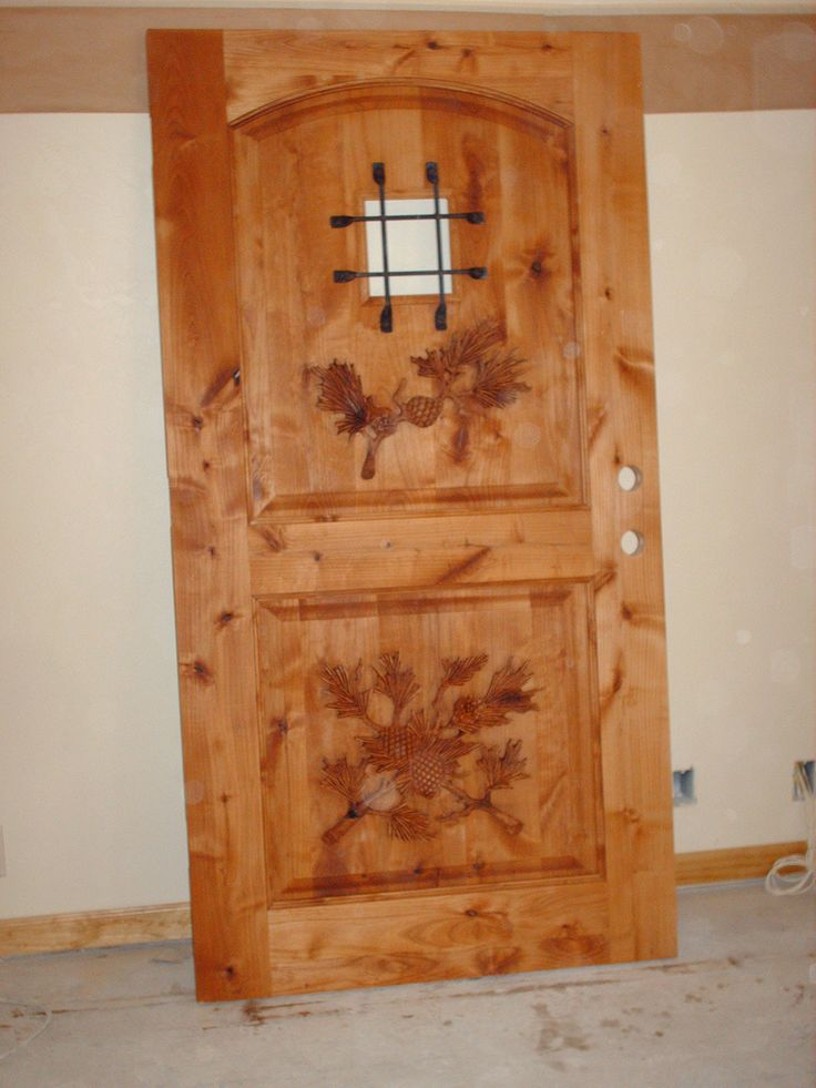 These hand carved wood doors are a unique but tasteful way