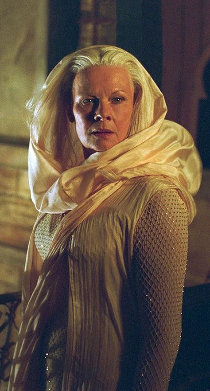 Judi Dench in The Chronicles of Riddick wearing an ethereal costume designed by Ellen Mirojnick and Michael Dennison