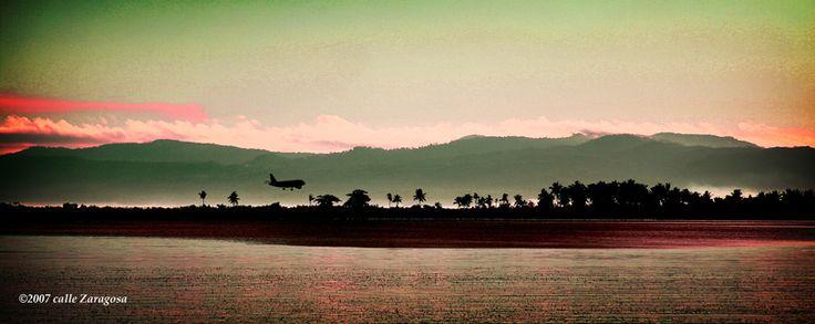 Tacloban City, capturing a plane from Manila about to land at the DZR International Airport in San Jose, Tacloban City. https://ExploreTraveler.com