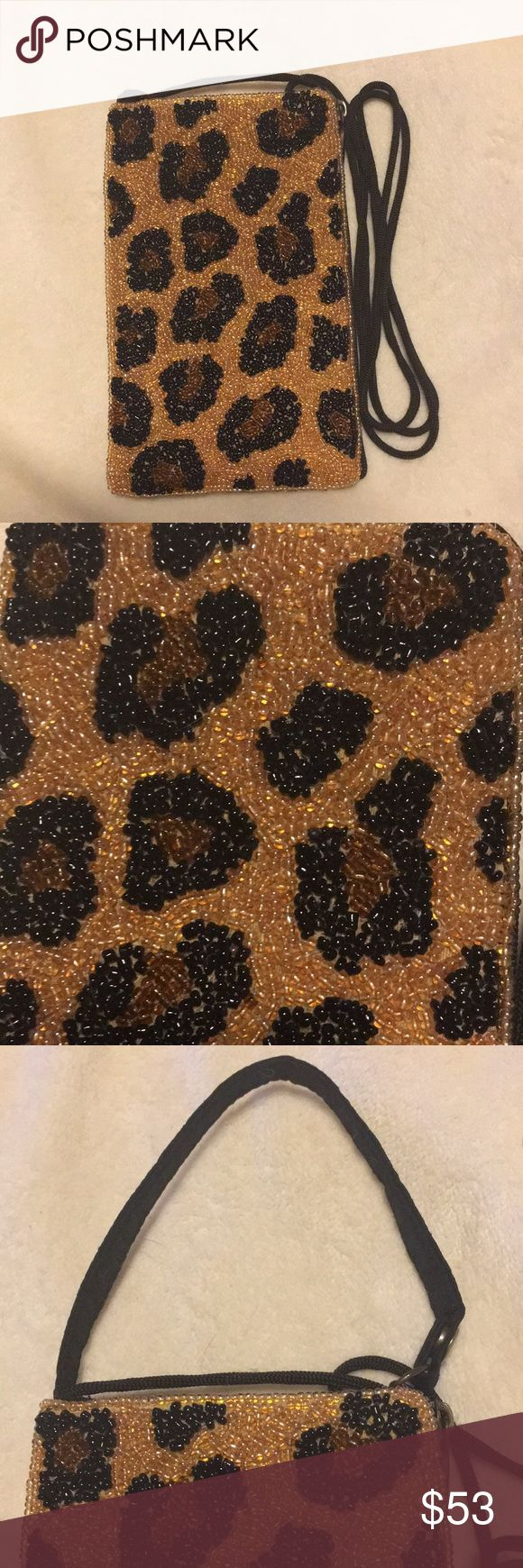 """Bamboo Trading Company beaded animal print cell Beautiful! Beaded animal print cross body cell phone - Fits iPhone plus, side zip for lip stock, money, credit card- Black, brown on gold- NWOT 24"""" hang or 4"""" hang Bamboo Trading Company Bags Crossbody Bags"""