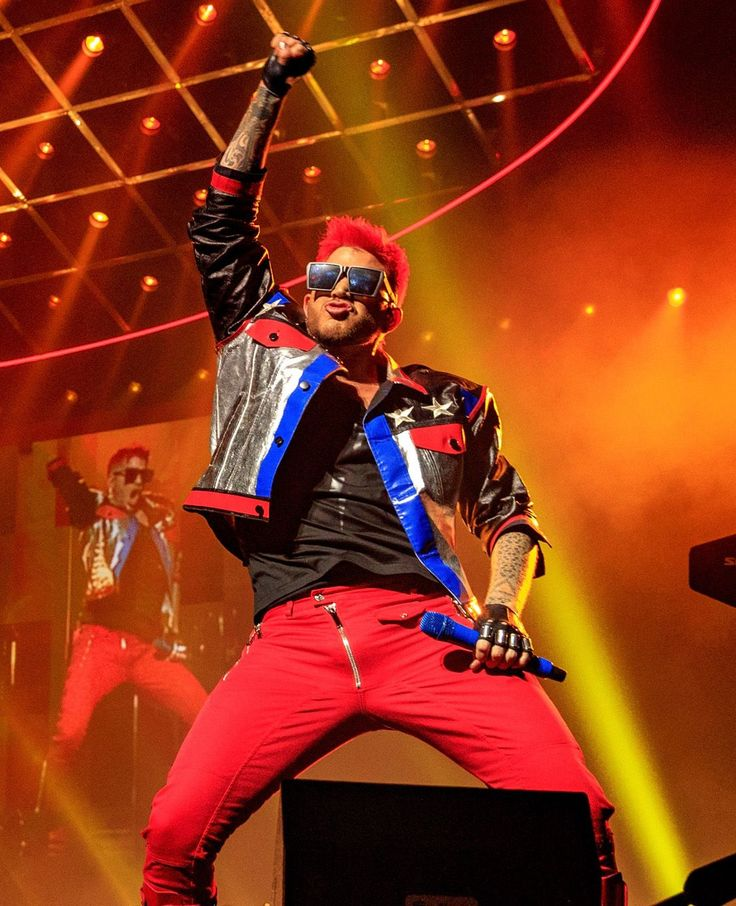 """Queen and Adam Lambert perform at the Gila River Arena in Glendale, Ariz.. June 23, 2017.  """"I think there's been talk that I'm going to be a judge [on American Idol] every year since I've been off the show,"""" chuckles Season 8 runner-up Adam Lambert, when he's asked about recent rumors that he'll be joining"""