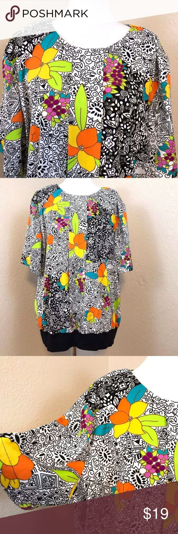 """Vintage Plus Size Flower Power Blouse Made in USA Vintage Top Notch Brand, Made in the U.S.A. . Pretty blouse with bright flowers on a black and white background.  100% polyester makes this top soft and wrinkle free with some stretch.  Button closure at back of neckline.  Size tag reads 46 / 26W which should be equivalent to a 4X  but PLEASE see measurements below.   Chest: Underarm to underarm 28"""" Waist:  Side seam to side seam across the front:  30"""" Length: 28""""   No holes, rips, stains or…"""
