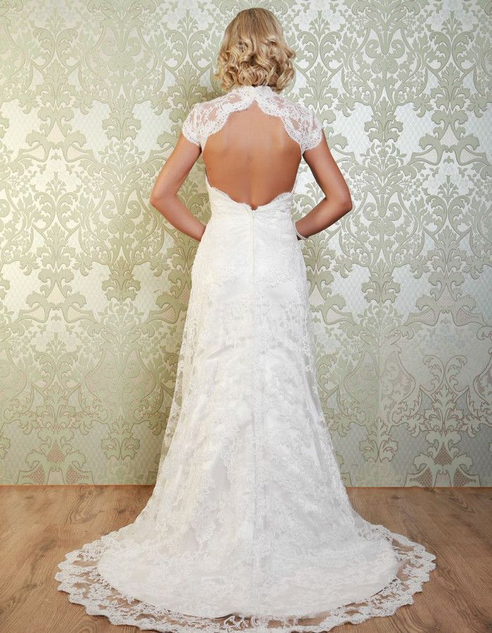 OBERON This beautiful lace gown has a high collar neckline and pretty cap sleeves. The delicate lace overlays a satin A-line gown. A gorgeous feature of the gown is the open keyhole back. https://www.wed2b.co.uk/vintage-wedding-dresses/viva-bride-oberon.php