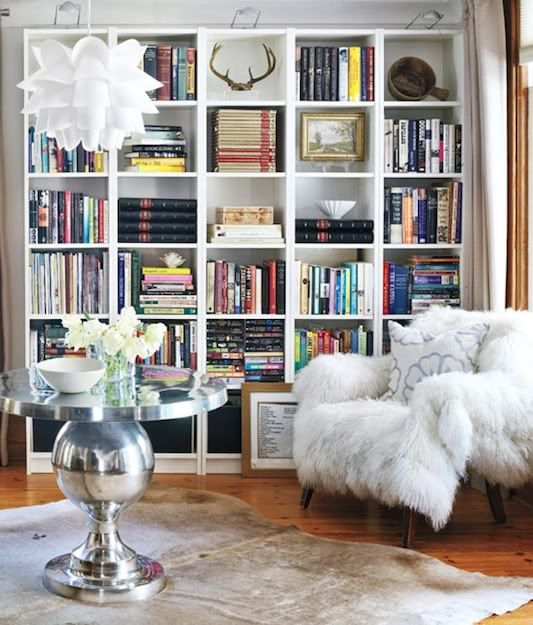 Giant bookcases, sheepskin rugs & silver tables!