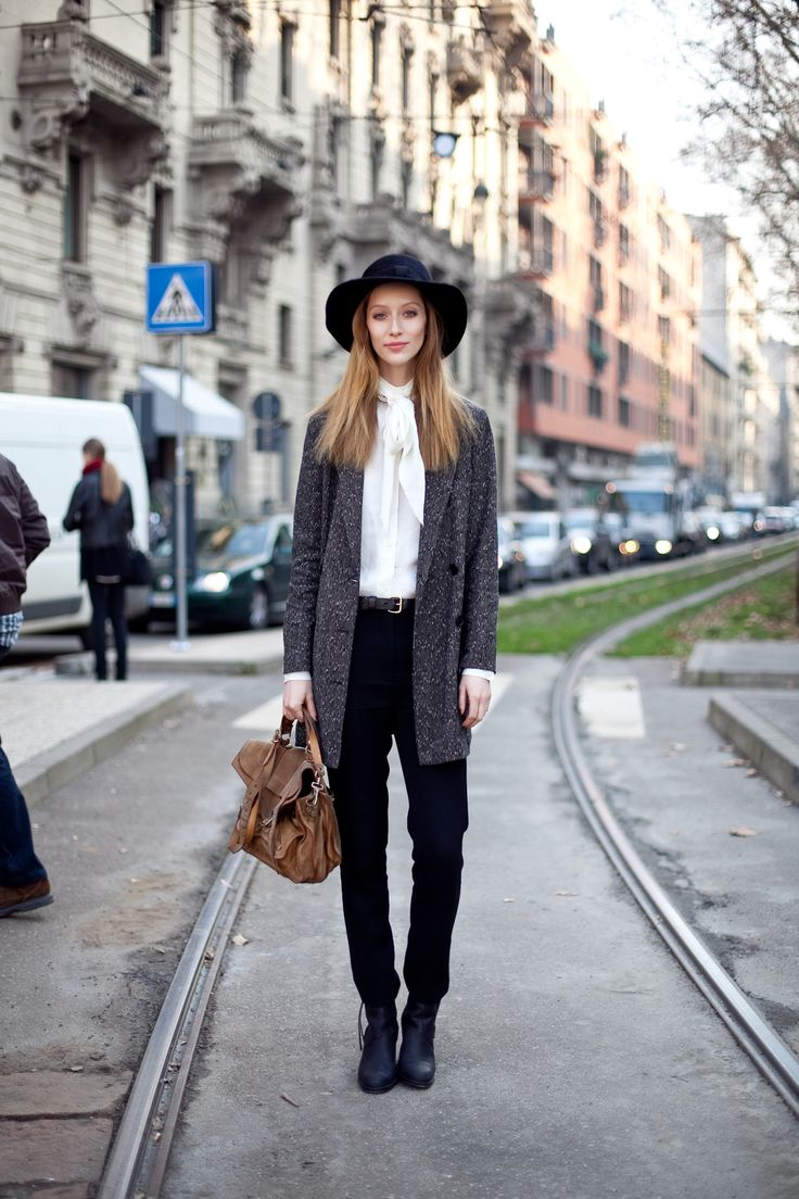Perfect: a leather messenger bag, grey long jacket, black wide brim hat, white blouse, and black loose pants