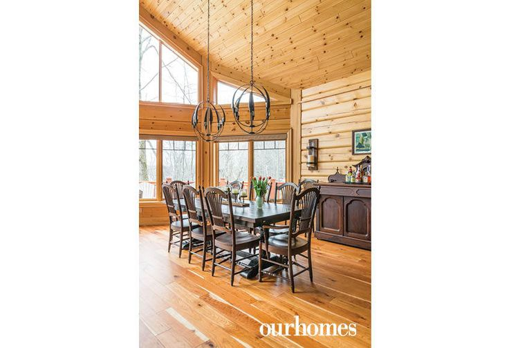 "Surrounded by wheat sheaf backed chairs, the dinner table extends to serve 10 people for dinner. The wooden sideboard is more than 100 years old.    See more of this home in ""Fifth Generation Legacy on Muskoka's Moon River"" from OUR HOMES Muskoka Early Summer 2017: http://www.ourhomes.ca/articles/build/article/fifth-generation-legacy-on-muskokas-moon-river"