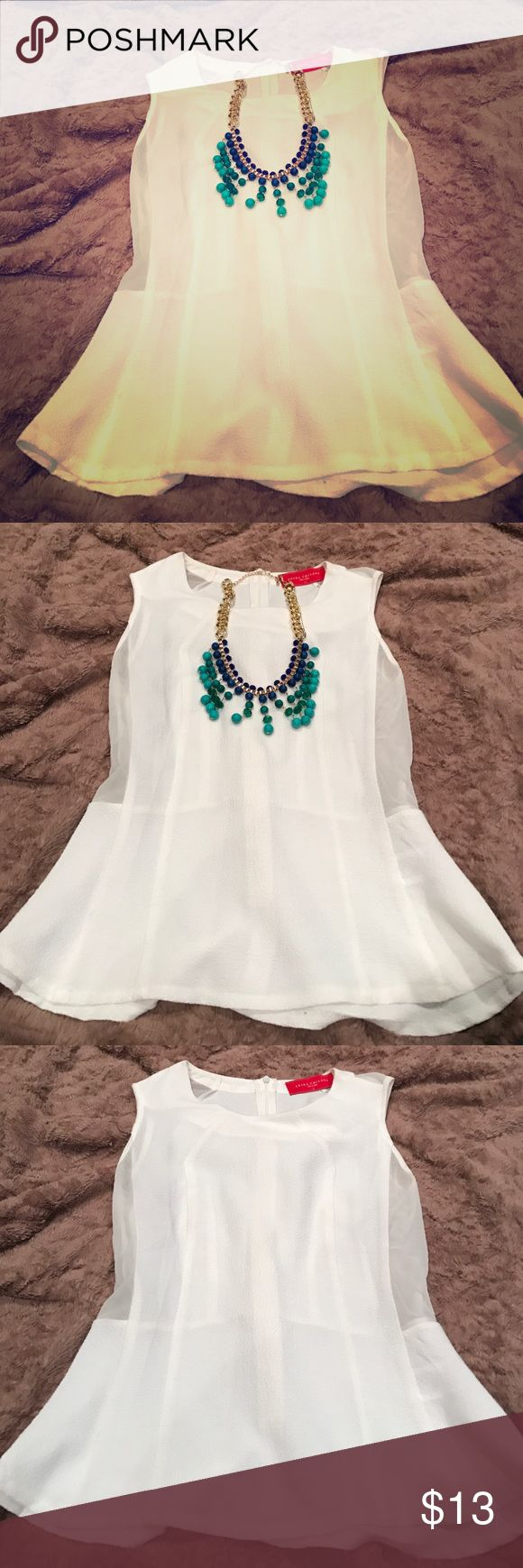 White peplum top and blue statement necklace. 2 for 1!! Sexy white peplum with sheer paneling on the sides. Zippered back.  Paired with this gorgeous blue statement necklace! AKIRA Tops Tank Tops