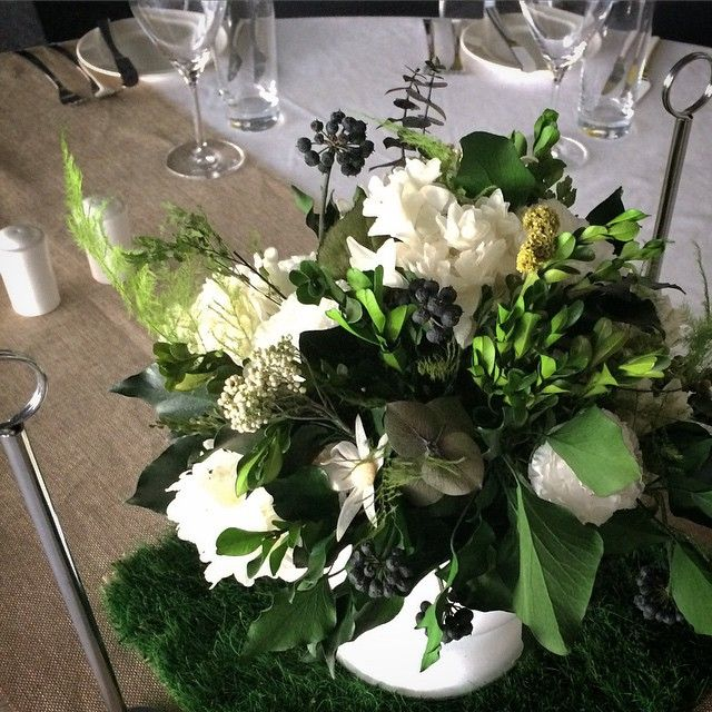 {Corporate Styling} Garden style table blooms sitting on preserved grass mats  #presrvedgreenery #preserved #flowers #tableflowers #tablecentrepiece #perth #pertharena #tennis #hopmancup #vip #graniteroom #perthflorist #boutique #blooms #poppyandwillow #bloomstylist #eventstyling