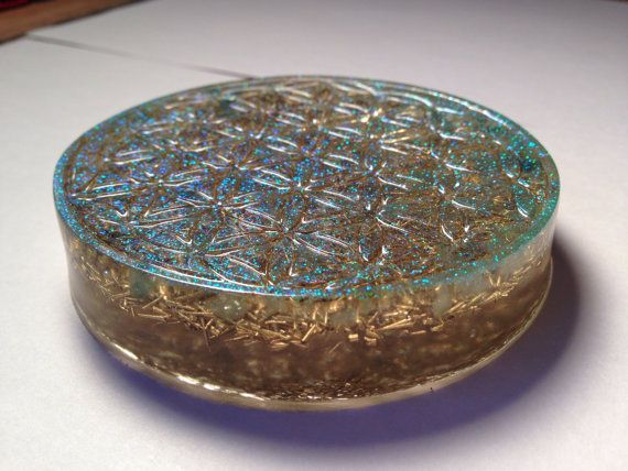 "__Flower Of Life Orgonite Charger_ Selenite, Aventurine, Brass & Glitter  - Orgonite Absorbs Wi-fi & Cell Phone Radiation -  - Breaks Up Chemtrails and Absorbs Negative Energies -  - Healing Energies, Spiritual Power, Grounding -  ****Properties of Orgone Energy****  -It is mass free  -it is omipressant. Orgone energy fills all space in differing degrees of concentration  -it is the medium for electromagnetic and gravitationa phenemona  -it is in constant motion  -It ""contradicts"" the law of…"