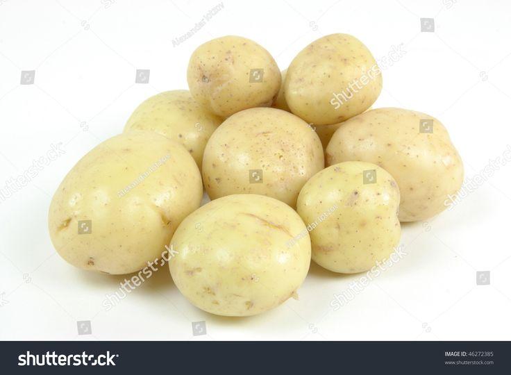 Pile fresh mini white potatoes - still life picture.