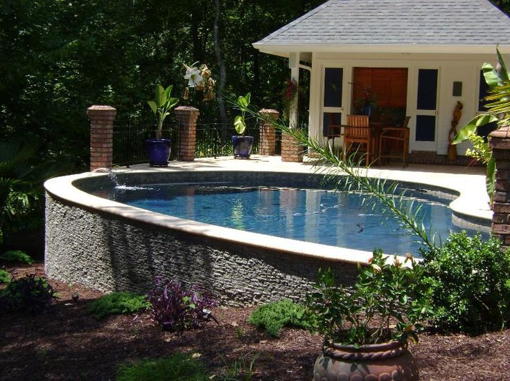 Pool design ideas good for a sloping yard would be - Above ground pools for small backyards ...