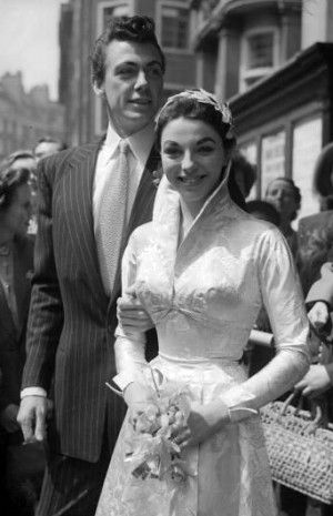 """May 24, 1952  At the young age of 18 actress Joan Collins wed her first husband, Irish actor Maxwell Reed, wearing a high collared, long-sleeved brocade wedding dress in a classic 50s-style silhouette."""