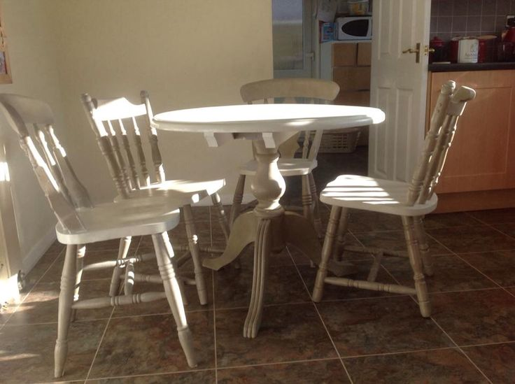 Beautiful table painted in old white and reindeer finished in a clear varnish.