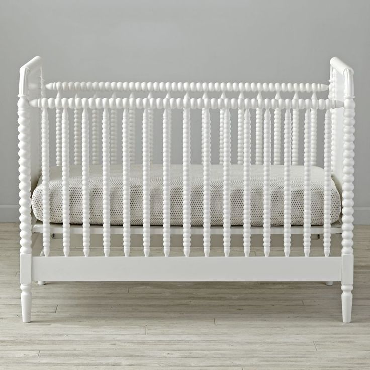 Adorned with elegantly crafted wood turnings, our Jenny Lind Crib effortlessly adds some vintage-inspired grandeur to any nursery. Its striking design can be styled traditionally or modernly, so it stands out or blends in with the rest of your décor. And, since it's made from quality materials like solid poplar, it's an instant heirloom piece.