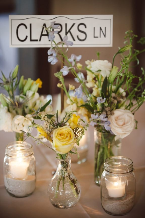 Sand in mason jars for candle holders! Love it especially since I want to use mason jars for center pieces!