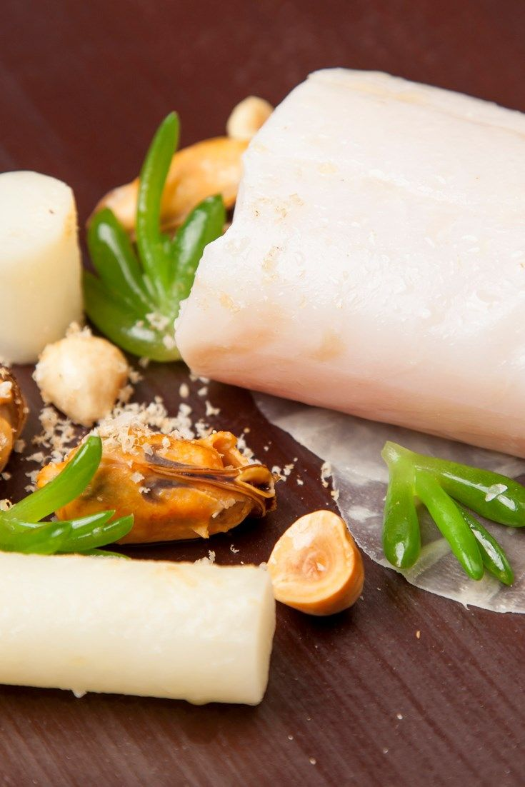 Chef Nigel Mendham allows pollock to be the star of his sous vide recipe. The poached pollock is matched with earthy celeriac, steamed mussels and crunchy hazelnuts. A fantastic poached fish recipe.