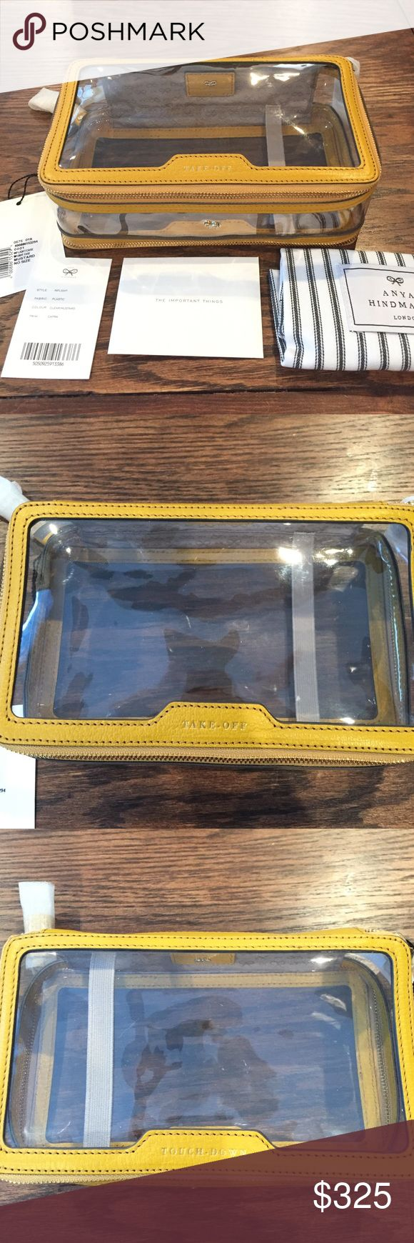Anya Hindmarch In-flight Cosmetic bag Clear cosmetic bag with yellow mustard leather trimming and leather tassel zipper pulls, perfect for traveling or every day use. One large compartment and a thin compartment with elastic band to hold brushes. Clear bag makes it easy to find things and both compartments make it easy to organize! Comes with original tags and dust bag. Anya Hindmarch Bags Cosmetic Bags & Cases
