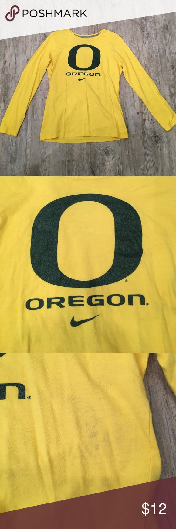 Slim fit Nike University or Oregon long sleeve tee Long sleeve, slim fit Nike University of Oregon Duck shirt. Only worn once to a championship game, but had a light stain on the front as pictured. Good condition! Nike Tops Tees - Long Sleeve