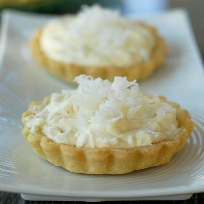 Coconut Cream Tart....I checked out the recipe and it looks fairly easy.....  perhaps a little time consuming but, these tarts would be worth it!    Would be a great #Easter dessert!  Can be made in pie form if preferred.