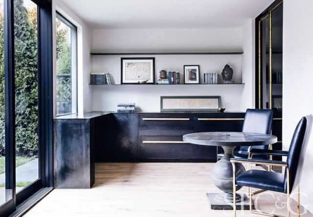Minimalist home office space with floor to ceiling windows