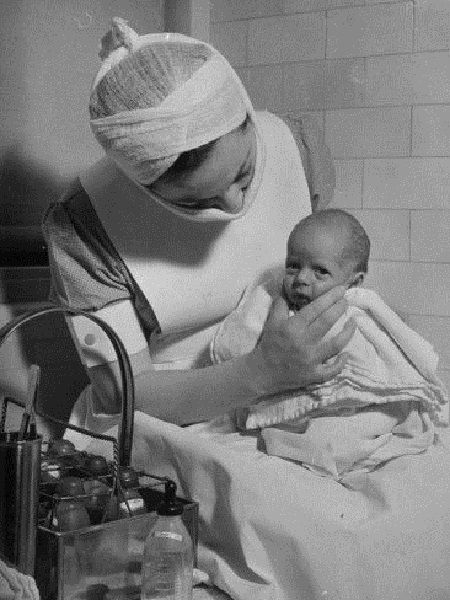Vintage photo of a nurse with a premature baby. 50 Vintage Photos of Nurses Being Awesome #Nursebuff #Vintage #Nurse