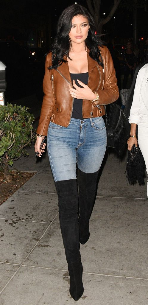 Rocker Chic from Kylie Jenner's Street Style  Lookin' good, Kylie! The 17-year-old makes a stylish stamen wearing an Acne brown leather jacket with thigh-high Sergio Rossi boots and her go-to 7 For All Mankind light-wash jeans.