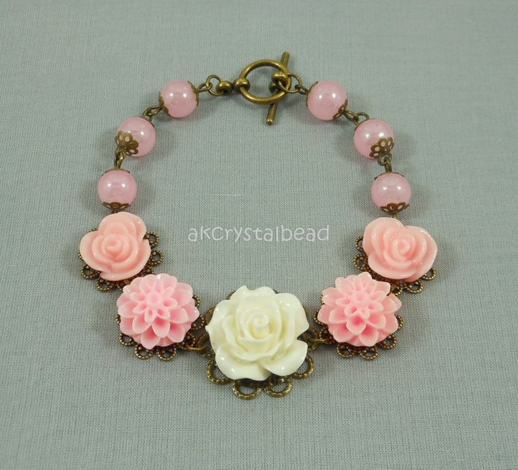 Pink / cream flower cabochon and pink glass bead bracelet. FSM0080