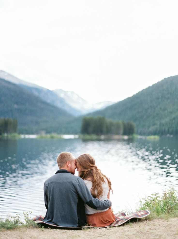 Nuzzling by a Colorado lake. Beautiful outdoor engagement shoot.  - Melissa Jill Photography