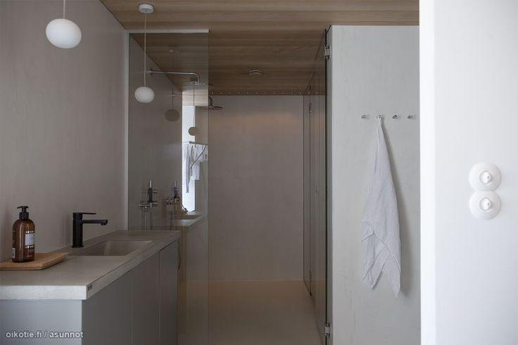Unique Home -mittatilauskalusteet kodinhoitohuoneessa.