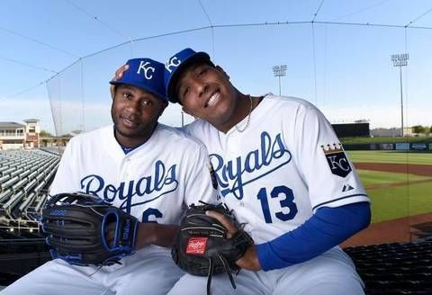 Kansas City Royals players Lorenzo Cain and Salvador Perez play around at photo day before Friday's spring training workout for the Royals on February 27, 2015 in Surprise, Ariz.