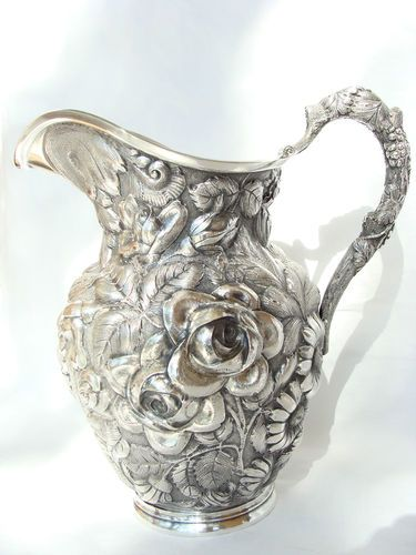 """Stieff  """"Baltimore Rose"""" sterling silver repousse water pitcher, c1928 (trinketplace)."""