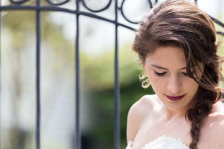 A San Diego bride with a loose side braid, wedding side braid, brunette medium length hair style for brides. Beautiful makeup and long lashes. Cavin Elizabeth Photography