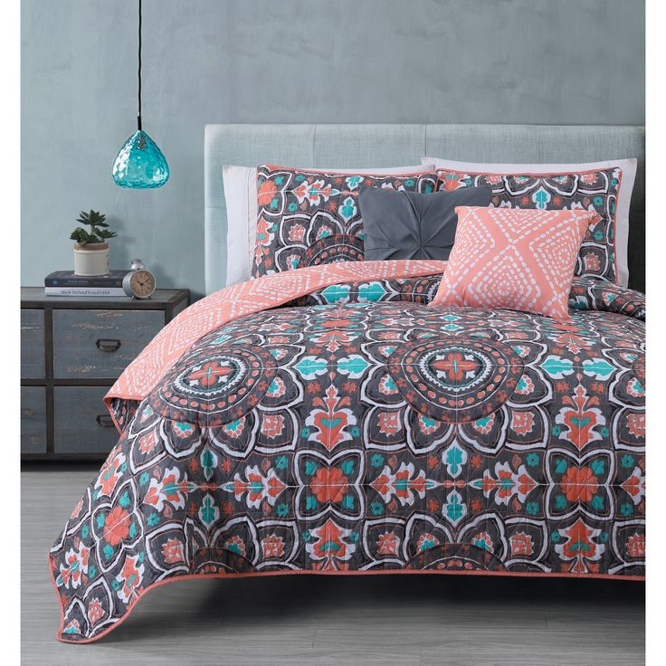 Dress your bed with this Ibiza 5-piece Quilt Set available in a navy, coral or grey/ yellow medallion print.