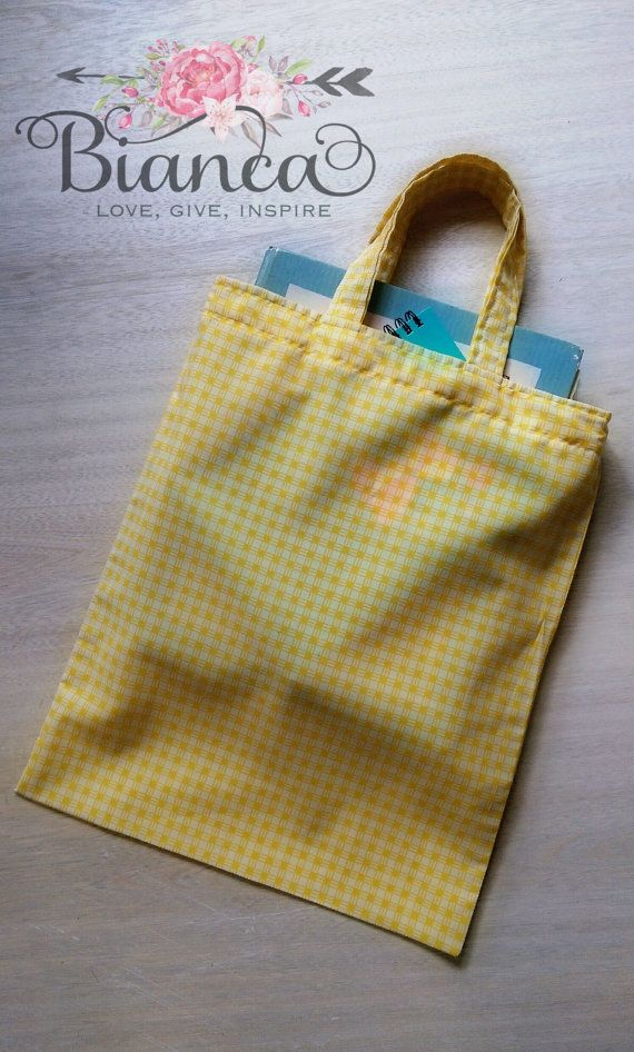 Yellow book bag https://www.etsy.com/au/listing/247552227/yellow-tote-library-bag-book-bag-fabric