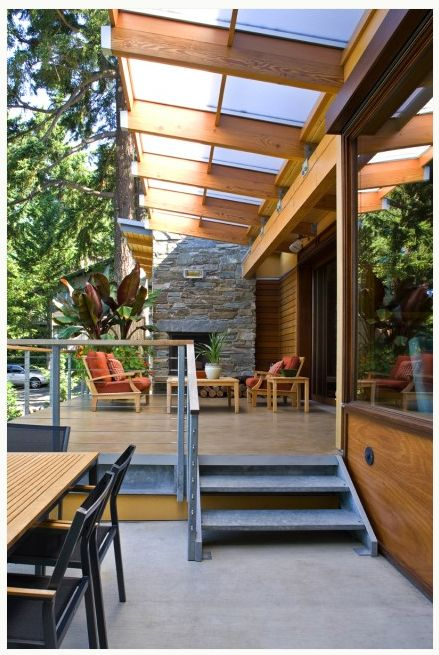 Deck Roof | Roof slanting towards house to allow for view of backyard and natural light through roofing panels